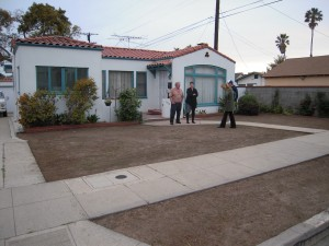 A yard about to be turned into an Ocean Friendly Garden. The lawn has been killed. The dirt is flat and compacted from years of lawn care.